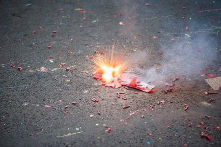 Firecracker exploding in the street Stock Photo