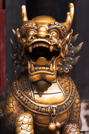 Bronze dragon statue in a chinese buddist temple