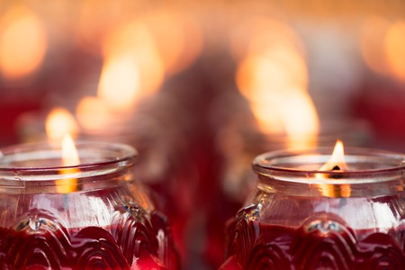 Red candles burning in a chinese buddhist temple