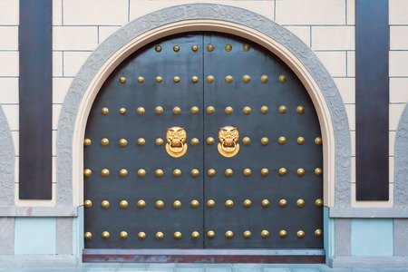 Chinese gate with golden colored door knockers, China Stock Photo