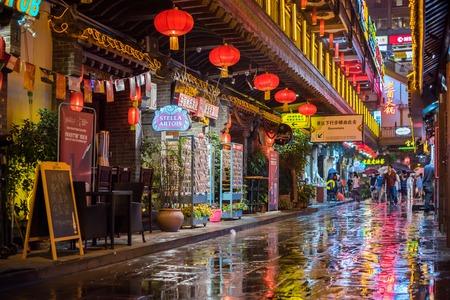 Hongya cave street market under the rain at night
