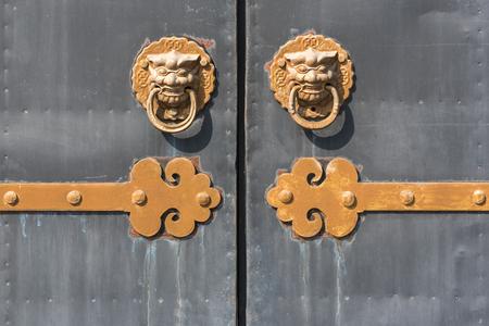 Golden colored chinese door knockers