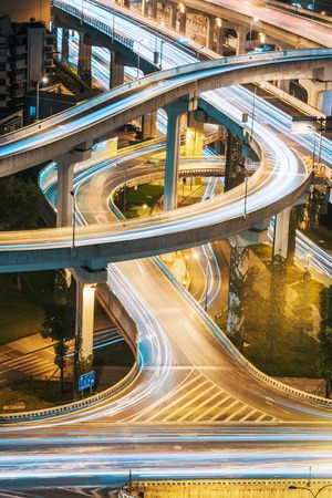 Urban elevated road junction and interchange overpass at night in Chengdu, China