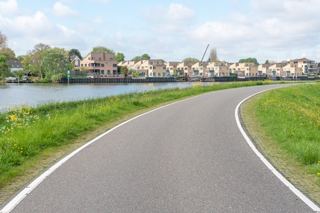 Empty curved road on a dam in the dutch countryside, Capelle Aan Den Ijssel, Netherlands Stock fotó