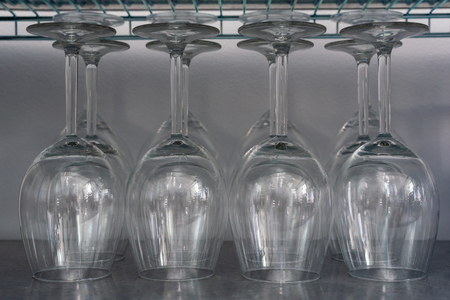 Rows of empty wine glasses close-up view