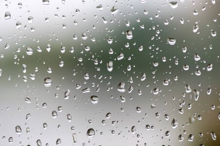 Water droplets on a window after the rain close-up view Imagens