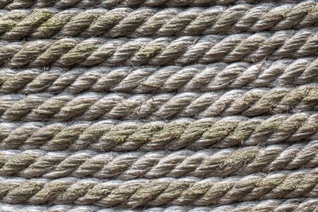 Tied rope texture in a row in parallel line background in closeup full frame Stock Photo