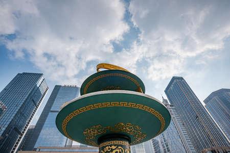 Chengdu, Sichuan province, China - Jan 29, 2020 : Circular sculpture in Tianfu square against skyscrapers and sky