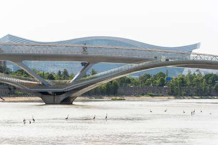Chengdu, Sichuan province, China - July 2, 2020: Wuchazi bridge above FuHe river against Global Center building
