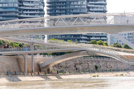 Chengdu, Sichuan province, China - July 2, 2020: Wuchazi bridge above FuHe river against skyscrapers