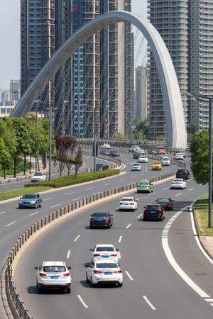 Chengdu, Sichuan province, China - July 2, 2020: HongXingLu KuaJinJiangQiao  also called butterfly bridge against skyscrapers panorama in daylight