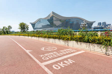 Chengdu, Sichuan province, China - Aug 26, 2020 : Chengdu Tianfu greenway track at Km 0 with New Century Global Center in the background 新闻类图片