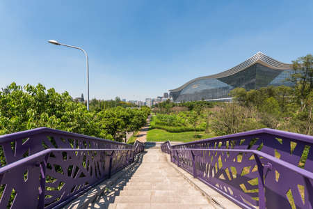 Chengdu, Sichuan province, China - Aug 26, 2020 : New Century Global Center building and stairs on a sunny day with clear blue sky 新闻类图片