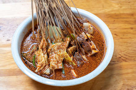 Boboji Sichuan dish - spicy cold skewer snack featuring chicken close-up view, Chengdu, Sichuan province, China 免版税图像