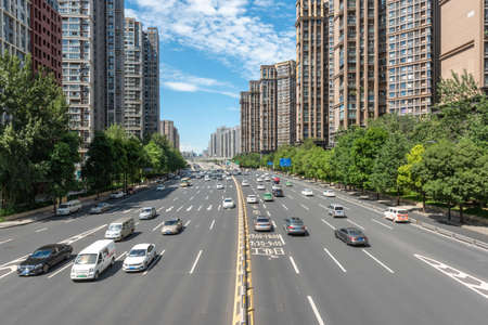 Chengdu, Sichuan province, China - Aug 24, 2020 : Traffic on multiple lanes large urban highway in KeHua south road in Chengdu on a sunny day
