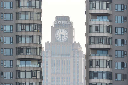 Chengdu, Sichuan province, China - July 2, 2020 : Global Times Center clock tower behind residential buildings