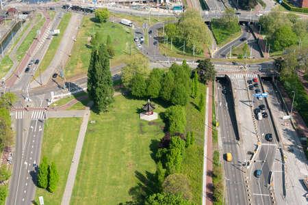 Rotterdam, Netherlands - April 29, 2019 : Het Dam Paviljoen in Parkhaven surrounded by roads aerial view 新闻类图片
