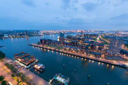 Rotterdam, Netherlands - May 7, 2019 : Delfshaven district skyline with modern buildings and new Meuse river aerial view at blue hour