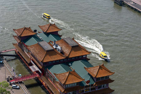 Rotterdam, Netherlands - April 29, 2019 : New Ocean Paradise floating Chinese restaurant aerial view