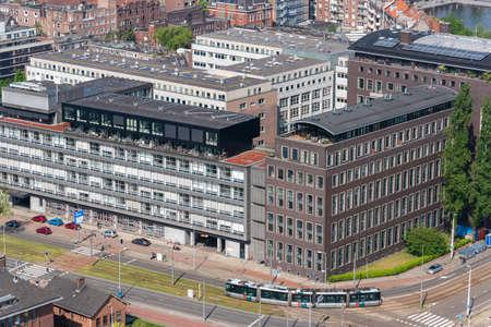 Rotterdam, Netherlands - April 29, 2019 : Tramway on Westzeedijk street aerial view on a sunny day 新闻类图片