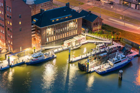 Rotterdam, Netherlands - May 7, 2019 : Rotterdam water police port illuminated at night aerial view