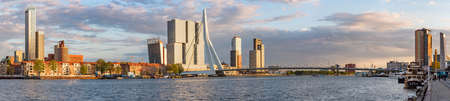 Rotterdam, Netherlands - april 26, 2019 : Downtown Rotterdam skyline panorama with Erasmus bridge and new Meuse river at sunset