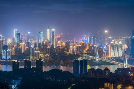 Chongqing, China - June 13, 2018 : Chongqing skyline aerial view and Dongshuimen cable bridge at night