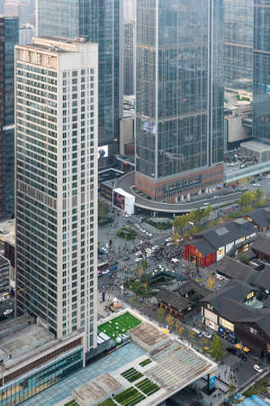Chengdu, Sichuan province, China - November 7, 2020 : Busy crossroads between Taikooli commercial area and IFS - International Financial Square - aerial view. 新闻类图片