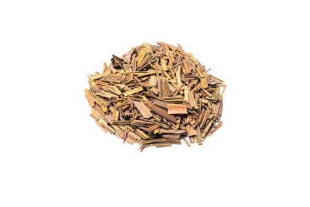 Organic dried lemongrass, latin name cymbopogon citratus heap on white background