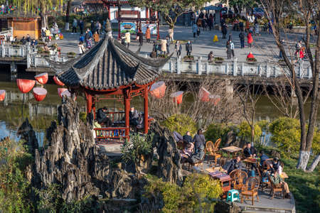 Chengdu, Sichuan province, China - Jan 17, 2021 : People enjoying a sunny day and drinking tea in Culture park.