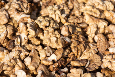 Heap of open walnuts on a market stall in Chengdu, Sichuan province, China