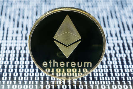Ethereum physical coin close-up view on binary code
