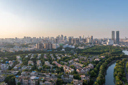 Chengdu, Sichuan province, China - Aug 11, 2019 - Chengdu city skyline aerial view in late afternoon with Jinjiang river.