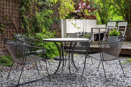 Empty table and chairs in a backyard in spring in the netherlands