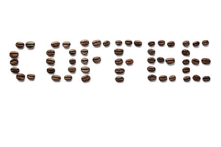 Coffee word title written with coffee beans isolated on white background