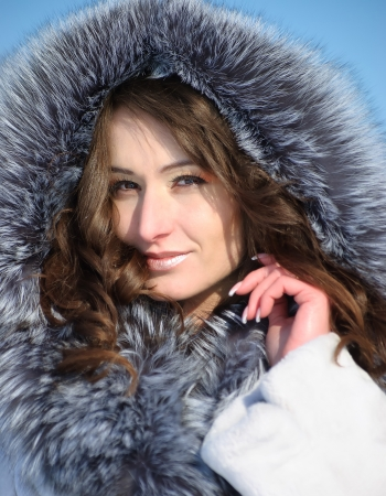 Portrait of Young Woman Wearing Winter Hood photo