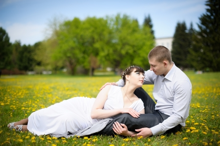Girl and boy lying on the grass photo
