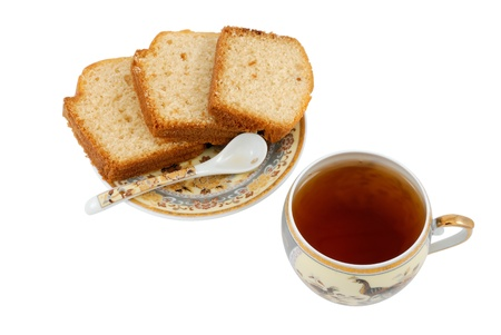 Teacup with cakes photo