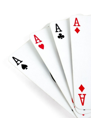 Four aces playing cards isolated on white photo