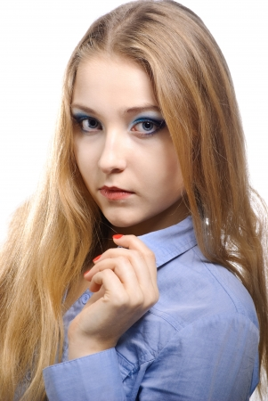 Portrait of a beautiful young woman wearing a blue shirt