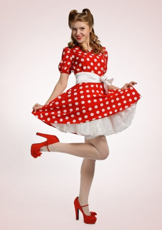pretty pinup model in a red and white polkadot dress photo