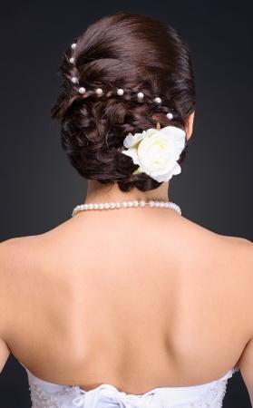 closeup of brunette bride hairstyle in studio photo