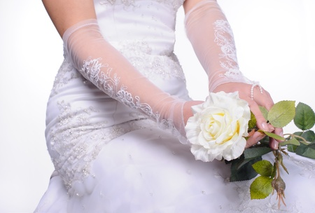 closeup hands of sitting bride with white rose Stock Photo
