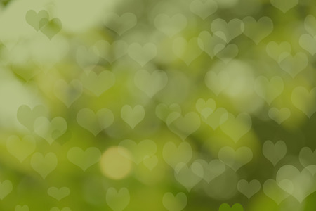 green heart bokeh abstract light background photo