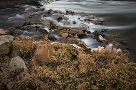 Running water at the river bank Stock Photo