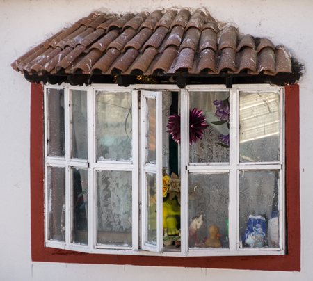 edifices: The window of an old house in Janitzio, Mexico Stock Photo