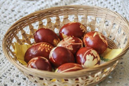 Hand dyed Easter eggs in a wicker basket Stok Fotoğraf