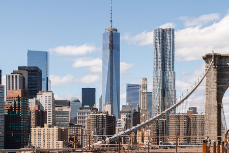 constant: The view of the skyscrapers of lower Manhattan, New York, as seen from the Brooklyn Bridge, being under constant construction Stock Photo