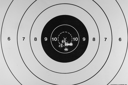 grouping: Nice tight grouping of five shots on a paper target