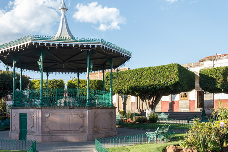 edifices: A gazebo at a plaza with  trees cut into square shapes in Quiroga, Michoacan, Mexico